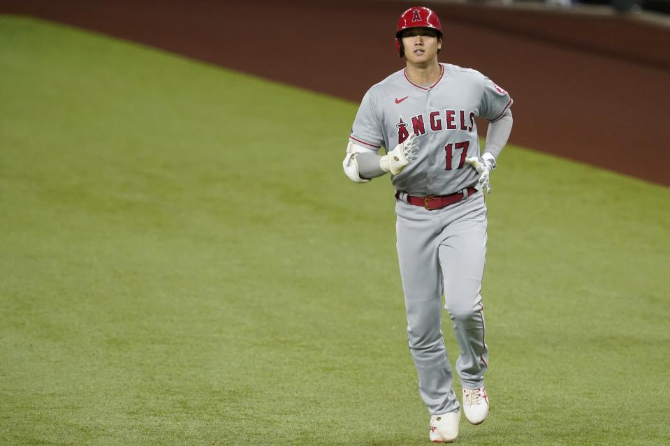 Los Angeles Angels' Shohei Ohtani jogs back to the dugout after grounding out during a baseball game against the Texas Rangers in Arlington, Texas, Wednesday, April 28, 2021. (AP Photo/Tony Gutierrez)