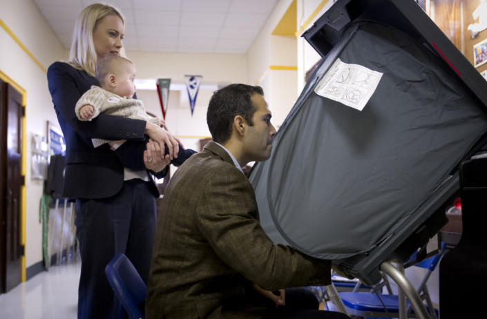 George P. Bush, with his wife Amanda and son Prescott, prepares to vote in the primary election Tuesday, March 4, 2014, at North High Mount Elementary School in Fort Worth, Texas. The 37-year-old nephew of former President George W. Bush, and son of former Florida Gov. Jeb Bush, is running for land commissioner in the state. (AP Photo/The Fort Worth Star-Telegram, Joyce Marshall) MAGS OUT; (FORT WORTH WEEKLY, 360 WEST)