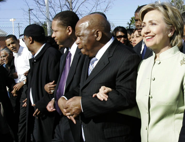 Democratic presidential candidates Barack Obama, far left, and Sen. Hillary Rodham Clinton, take part in the traditional walk across the Edmund Pettus Bridge to commemorate the 42nd anniversary of the 1965 Selma to Montgomery March on March 4, 2007. Rep. John Lewis, D-Ga., is second from right. (Photo: Rob Carr/AP)