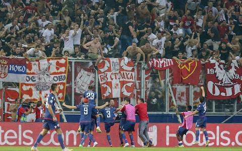 <span>Red Star Belgrade players celebrate after their surprise away draw confirmed a place in the Champions League group stages</span>