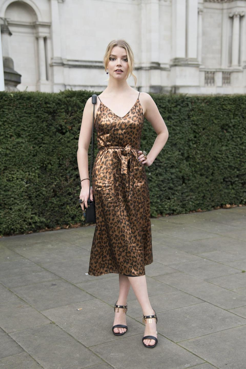 <p>Anya wore a leopard print dress to the Christopher Kane show.</p>