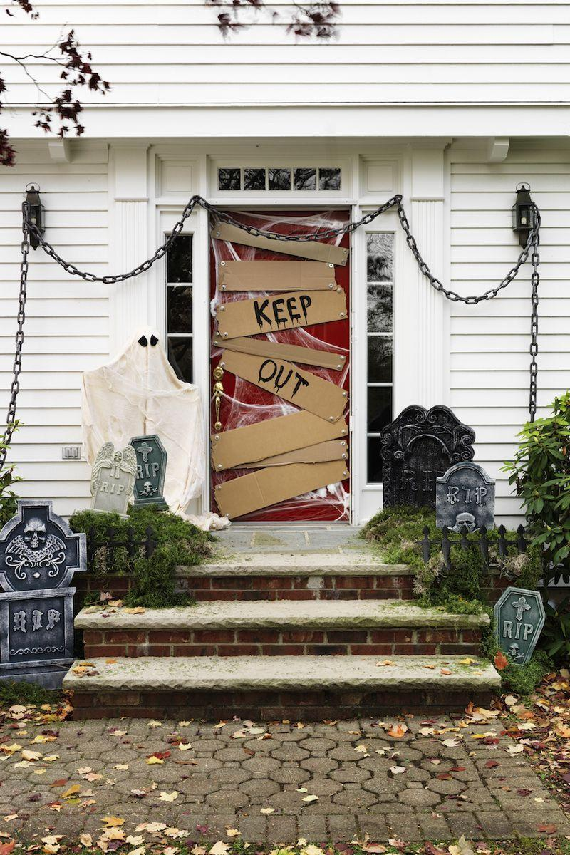 """<p>When it comes to <a href=""""https://www.goodhousekeeping.com/holidays/halloween-ideas/g421/halloween-decorating-ideas/"""" rel=""""nofollow noopener"""" target=""""_blank"""" data-ylk=""""slk:Halloween decor"""" class=""""link rapid-noclick-resp"""">Halloween decor</a>, your first thought might be to <a href=""""https://www.goodhousekeeping.com/holidays/halloween-ideas/g238/pumpkin-carving-ideas/"""" rel=""""nofollow noopener"""" target=""""_blank"""" data-ylk=""""slk:carve pumpkins"""" class=""""link rapid-noclick-resp"""">carve pumpkins</a> for a table arrangement or hang a fun and spooky banner to make a drab room more festive. While these are certainly no-fail Halloween decor ideas, there's one element that you shouldn't overlook: your front door. Make a great first impression this year with these Halloween door decorations that are guaranteed to be the talk of your neighborhood. Whether you love all things creepy of prefer understated Halloween decor, you're sure to find a favorite here. </p>"""