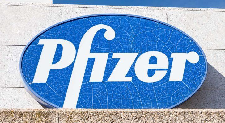 Pfizer (PFE) logo on Pfizer building. Pfizer is an American pharmaceutical corporation.