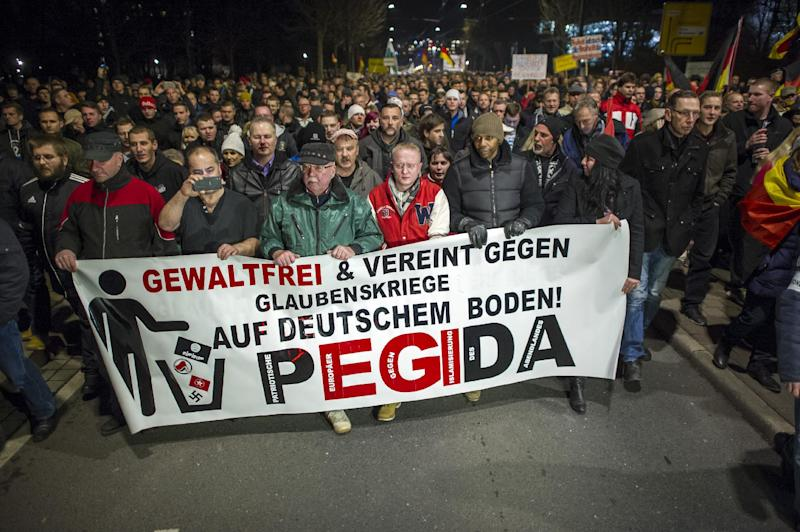 "A picture taken on December 15, 2014 shows supporters of the PEGIDA movement, ""Patriotische Europaeer gegen die Islamisierung des Abendlandes,"" which translates to ""Patriotic Europeans Against the Islamification of the Occident,"" (AFP Photo/Jens Schlueter)"
