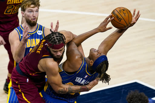 Cleveland Cavaliers center JaVale McGee (6) fouls Indiana Pacers forward Myles Turner (33) as he shoots during the first half of an NBA basketball game in Indianapolis, Thursday, Dec. 31, 2020. (AP Photo/Michael Conroy)