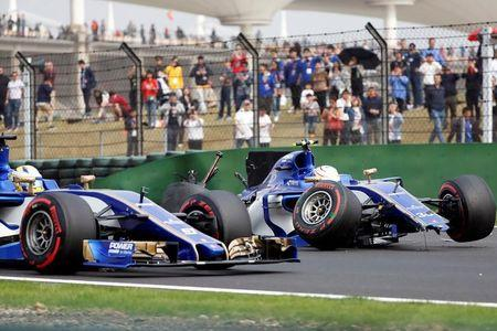 Formula One - F1 - Chinese Grand Prix - Shanghai, China - 08/04/17 - Sauber driver Marcus Ericsson of Sweden drives past Sauber driver Antonio Giovinazzi of Italy after he crashed during the qualifying session at the Shanghai International Circuit. REUTERS/Aly Song