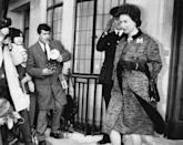 <p>Between the textured print, boxy shift dress and matching coat, Queen Elizabeth's bump was barely visible in this outfit while she was pregnant with Prince Edward. </p>