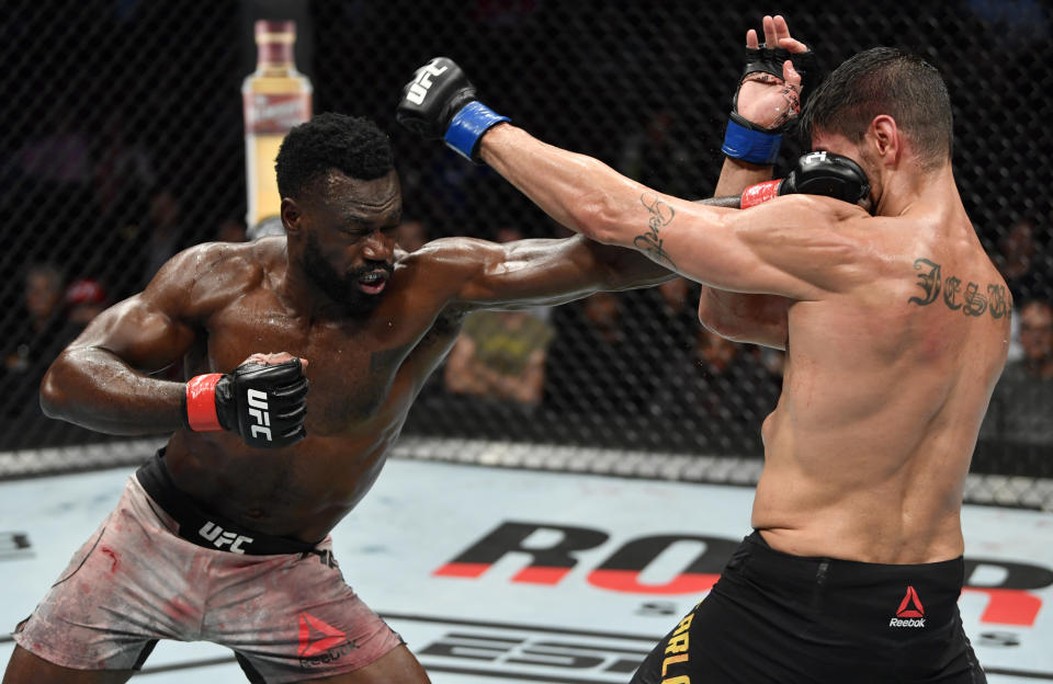 VANCOUVER, BRITISH COLUMBIA - SEPTEMBER 14:  (L-R) Uriah Hall of Jamaica punches Antonio Carlos Junior of Brazil in their middleweight bout during the UFC Fight Night event at Rogers Arena on September 14, 2019 in Vancouver, Canada. (Photo by Jeff Bottari/Zuffa LLC/Zuffa LLC)