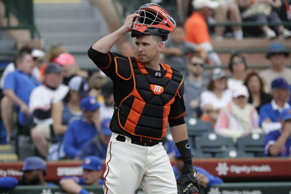 San Francisco Giants catches Buster Posey against the Chicago Cubs during the first inning of a spring training baseball game Tuesday, March 10, 2020, in Scottsdale, Ariz. (AP Photo/Matt York)