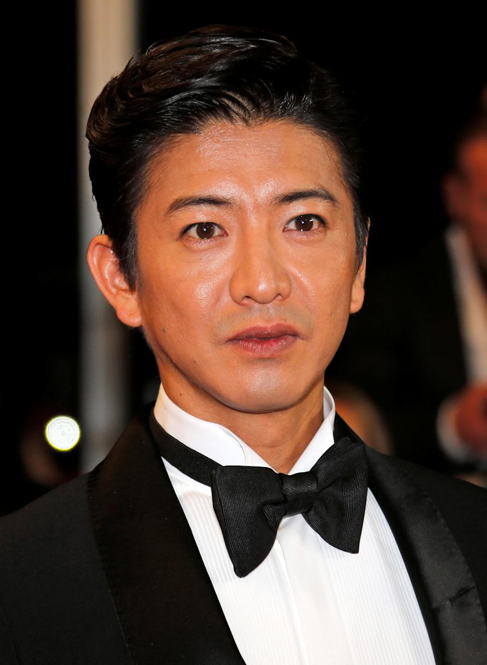 """70th Cannes Film Festival - Screening of the film """"Mugen no junin"""" (Blade of the Immortal) out of competition - Red Carpet Arrivals - Cannes, France. 18/05/2017. Cast memberTakuya Kimura poses. REUTERS/Jean-Paul Pelissier"""