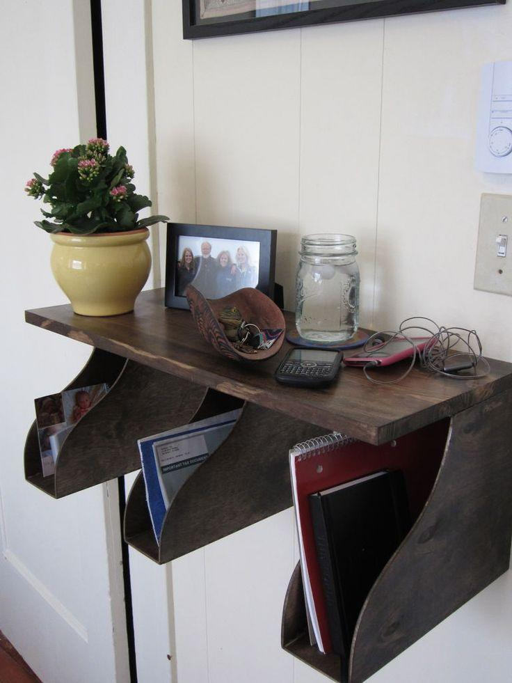 """<p>Three magazine organizers attached to the bottom of a floating shelf can provide spots for every person in the family to have a personalized nook for important papers.</p><p>Get the tutorial at <a href=""""http://www.instructables.com/id/IKEA-Hack-Mail-Rack/"""" rel=""""nofollow noopener"""" target=""""_blank"""" data-ylk=""""slk:Instructables"""" class=""""link rapid-noclick-resp"""">Instructables</a>.</p><p><a class=""""link rapid-noclick-resp"""" href=""""https://go.redirectingat.com?id=74968X1596630&url=https%3A%2F%2Fwww.ikea.com%2Fus%2Fen%2Fcatalog%2Fproducts%2F60203957%2F&sref=https%3A%2F%2Fwww.countryliving.com%2Fhome-maintenance%2Fg37186772%2Fentryway-ikea-hacks%2F"""" rel=""""nofollow noopener"""" target=""""_blank"""" data-ylk=""""slk:BUY NOW"""">BUY NOW</a> <em><strong>Magazine Files, $13</strong></em></p>"""