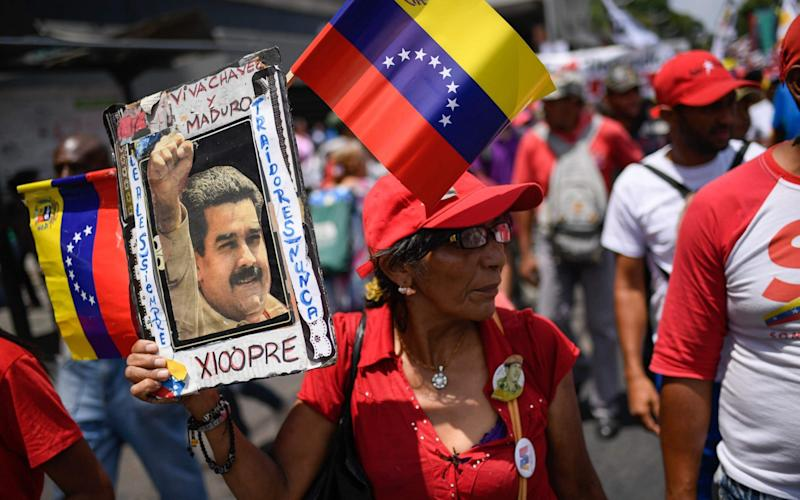 Government supporters attend a rally in the surroundings of Miraflores Presidential Palace in Caracas on May 20, 2019 to mark the one year anniversary of President Nicolas Maduro's re-election - AFP
