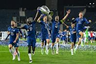 Chelsea players celebrate with the trophy after beating Manchester City in the Champions League final in Porto