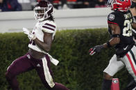 Mississippi State wide receiver Jaden Walley (31) scores a touchdown next to Georgia defensive back Christopher Smith during the first half of an NCAA college football game, Saturday, Nov. 21, 2020, in Athens, Ga. (AP Photo/Brynn Anderson)