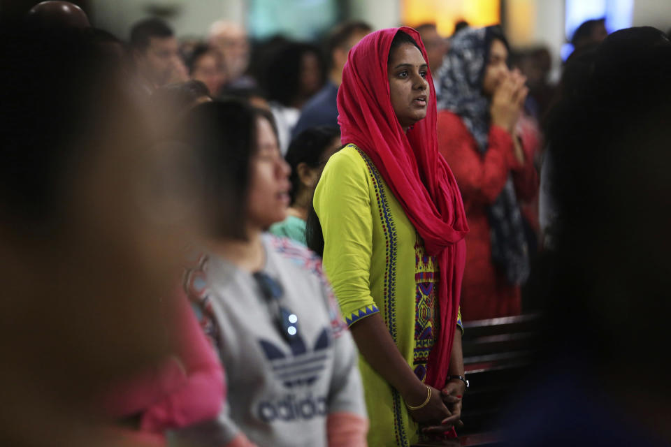 In this Sunday, Jan. 20, 2019 photo, a woman prays during Mass at St. Mary's Catholic Church in Dubai, United Arab Emirates. Pope Francis' visit to the United Arab Emirates from Feb. 3 through Feb. 5, marks the first ever papal visit to the Arabian Peninsula, the birthplace of Islam. The Catholic Church believes there are some 1 million Catholics in the UAE today. The backbone of that population is Filipino and Indian. (AP Photo/Jon Gambrell)