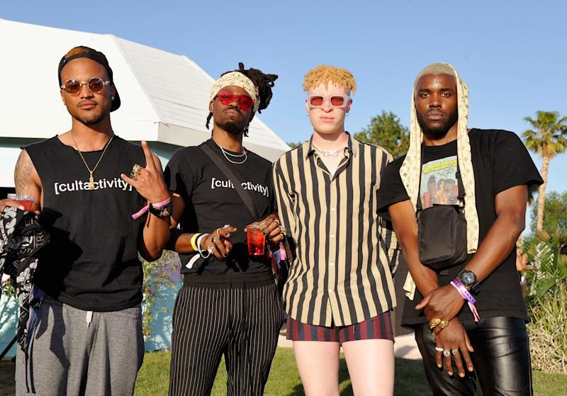 Shaun D. Ross, second from right, and guests attend the FentyXPUMA Drippin event launching the Summer '18 collection at Coachella on April 14, 2018 in Thermal, California. (Photo by John Sciulli/Getty Images for PUMA)