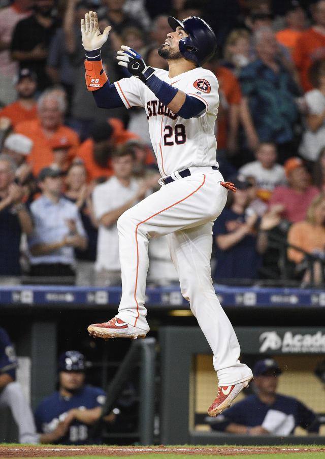 Houston Astros' Robinson Chirinos leaps after hitting a two-run home run off Milwaukee Brewers relief pitcher Jacob Barnes during the seventh inning of a baseball game, Tuesday, June 11, 2019, in Houston. (AP Photo/Eric Christian Smith)