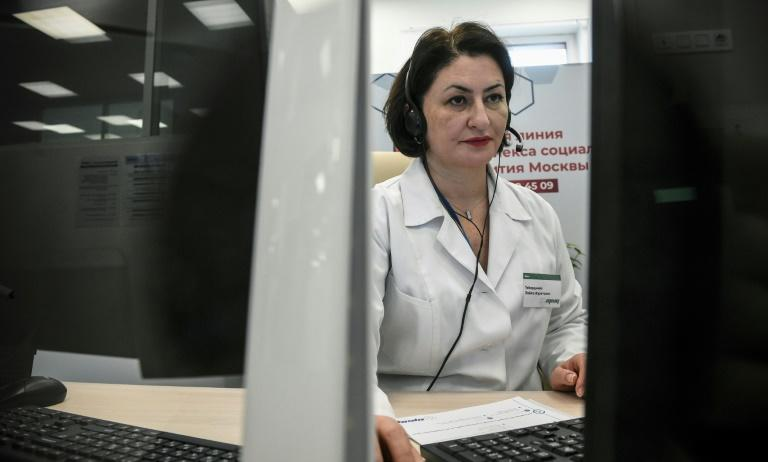 Governments and private firms have set up telemedicine clinics for patients who suspect they have the new coronavirus (AFP Photo/Alexander NEMENOV)