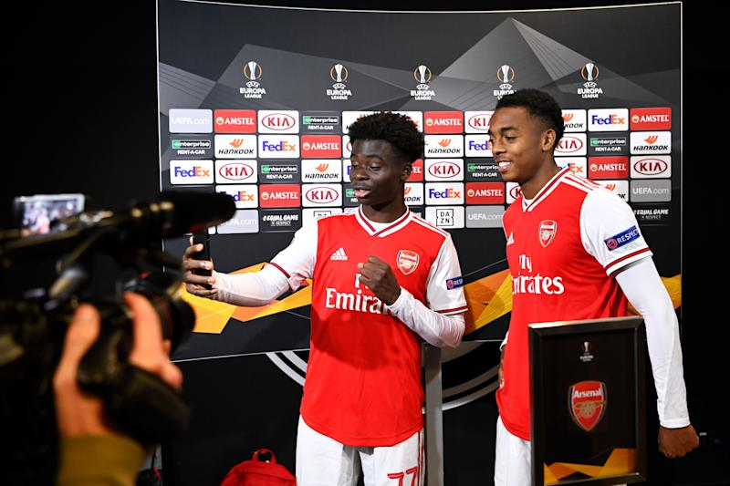 FRANKFURT AM MAIN, GERMANY - SEPTEMBER 19: Bukayo Saka and Joe Willock (L-R) of Arsenal FC gives an interview in the mixed zone after the UEFA Europa League group F match between Eintracht Frankfurt and Arsenal FC at Commerzbank Arena on September 19, 2019 in Frankfurt am Main, Germany. (Photo by Oliver Hardt - UEFA/UEFA via Getty Images)