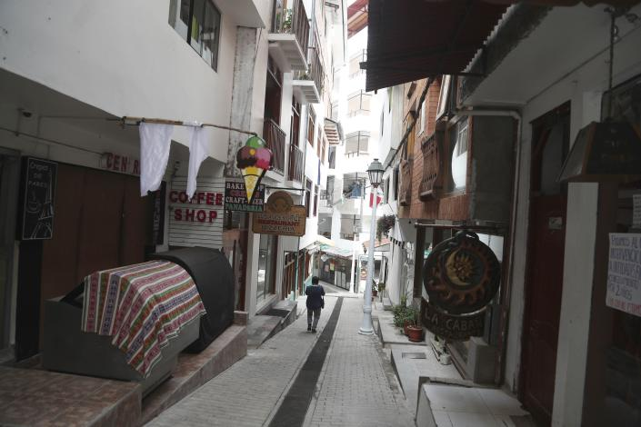Restaurants are closed amid the COVID-19 pandemic in Aguas Calientes, at the base of Macchu Pichu, Peru, Tuesday, Oct. 27, 2020. The world-renown Incan citadel of Machu Picchu will reopen to the public on Nov. 1. (AP Photo/Martin Mejia)