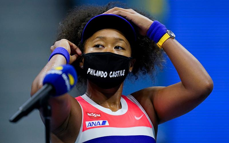 Naomi Osaka, of Japan, adjusts her mask after defeating Jennifer Brady, of the United States, during a semifinal match of the US Open tennis championships, Thursday, Sept. 10, 2020, in New York. - AP