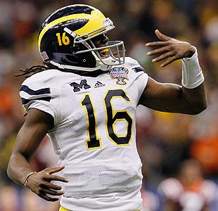 Denard Robinson's stellar play and charisma has made him a big fan favorite in Michigan. (Getty)