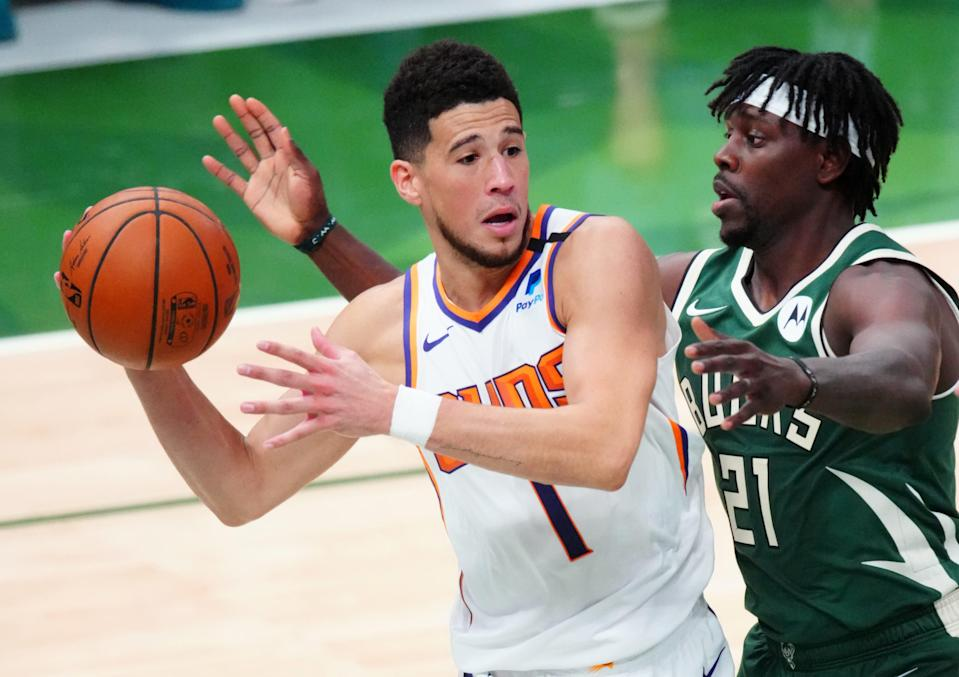Suns guard Devin Booker (1) and Bucks guard Jrue Holiday will go from competing against each other to being Olympic teammates.