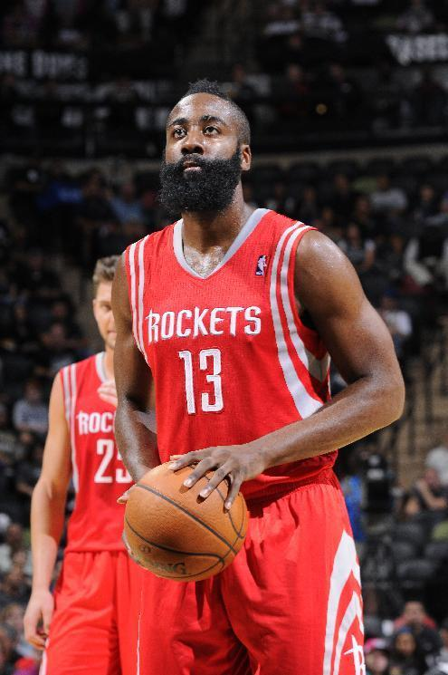 SAN ANTONIO, TX - OCTOBER 24: James Harden #13 of the Houston Rockets shoots a free throw during the last preseason game against the San Antonio Spurs at the AT&T Center on October 24, 2013 in San Antonio, Texas