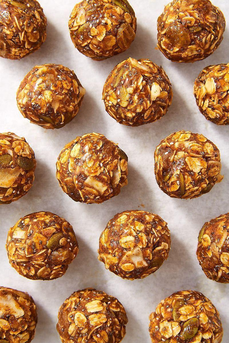 """<p>These """"energy balls"""" are exactly what they sound like: perfect little bites of energy that will help you curb cravings for something sweet when you really need something. Made with oats, coconut, almond butter, and pumpkin puree, they're totally healthy and satisfying.</p><p>Get the <a href=""""https://www.delish.com/uk/cooking/recipes/a34200702/pumpkin-pie-energy-balls-recipe/"""" rel=""""nofollow noopener"""" target=""""_blank"""" data-ylk=""""slk:Pumpkin Pie Energy Ball"""" class=""""link rapid-noclick-resp"""">Pumpkin Pie Energy Ball</a>s recipe.</p>"""