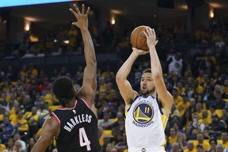FILE PHOTO: May 14, 2019; Oakland, CA, USA; Golden State Warriors guard Klay Thompson (11) shoots the basketball against Portland Trail Blazers forward Maurice Harkless (4) during the second quarter in game one of the Western conference finals of the 2019 NBA Playoffs at Oracle Arena. Mandatory Credit: Kyle Terada-USA TODAY Sports
