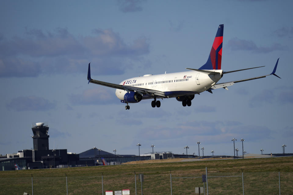 A Delta Airlines flight from Atlanta makes its landing approach onto Baltimore-Washington International Thurgood Marshall Airport, Monday, Nov. 23, 2020, in Glen Burnie, Md. (AP Photo/Julio Cortez)