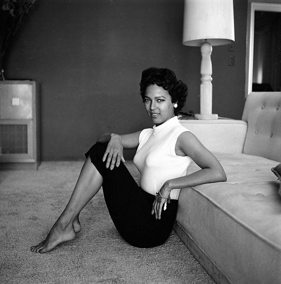 <p>She broke ground as the first Black actress to be nominated for the Best Actress Academy Award in 1954 and starred in films such as <em>Carmen Jones</em> and <em>Porgy and Bess</em>. Dorothy Dandridge grew up in California with a mother who was also an actress and entertainer. Here, Dandridge casually poses in her California home the same year she was nominated for an Oscar.</p>