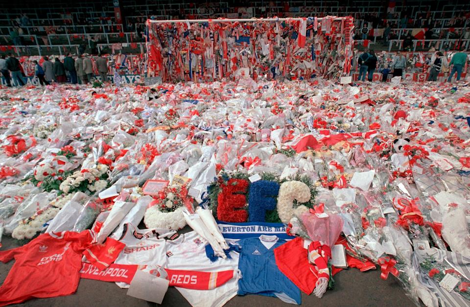 <p>Flower tributes cover the 'Kop' at Anfield in Liverpool, on 17 April 1989</p> (PA)