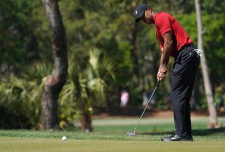 Mar 11, 2018; Palm Harbor, FL, USA; Tiger Woods putts on the 3rd during the final round of the Valspar Championship golf tournament at Innisbrook Resort - Copperhead Course. Jasen Vinlove-USA TODAY Sports
