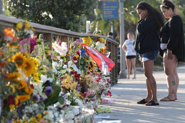 PHOTO: Women looks at flower tributes in Santa Barbara Harbor at a makeshift memorial for victims of the Conception boat fire, Sept. 3, 2019, in Santa Barbara, Calif. (Mario Tama/Getty Images)