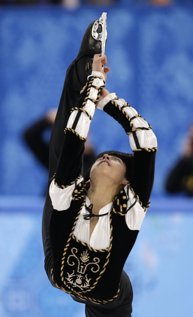 Michael Christian Martinez of the Philippines competes in the men's short program figure skating competition at the Iceberg Skating Palace during the 2014 Winter Olympics, Thursday, Feb. 13, 2014, in Sochi, Russia. (AP Photo/Bernat Armangue)
