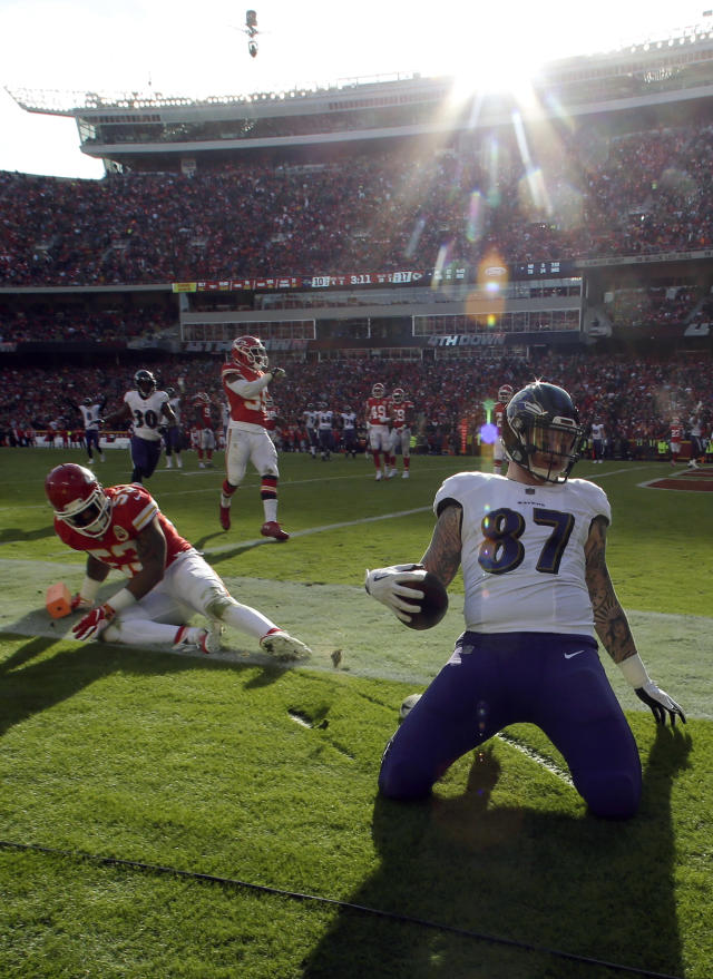 <p>Baltimore Ravens tight end Maxx Williams (87) scores a touchdown past Kansas City Chiefs linebacker Anthony Hitchens (53) during the second half of an NFL football game in Kansas City, Mo., Sunday, Dec. 9, 2018. (AP Photo/Charlie Riedel) </p>