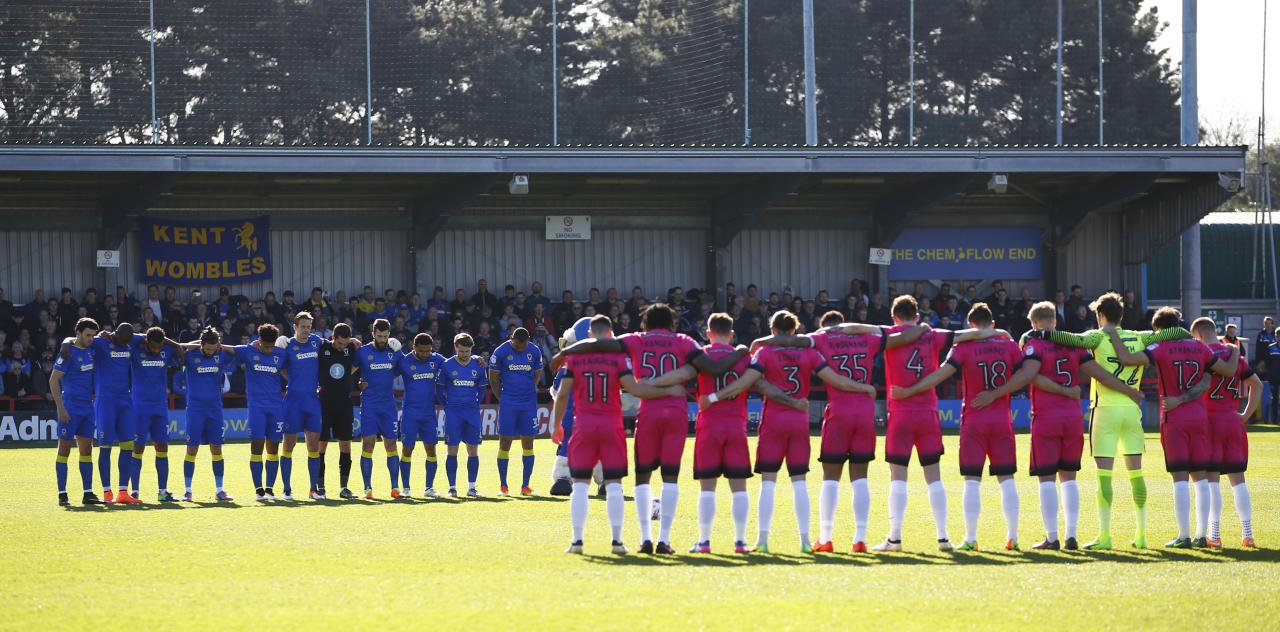 "Britain Football Soccer - AFC Wimbledon v Southend United - Sky Bet League One - Cherry Red Records Stadium - 25/3/17 Players observe a minutes silence in respect for the victims of the London attack before the game  Action Images via Reuters / Peter Cziborra Livepic EDITORIAL USE ONLY. No use with unauthorized audio, video, data, fixture lists, club/league logos or ""live"" services. Online in-match use limited to 45 images, no video emulation. No use in betting, games or single club/league/player publications.  Please contact your account representative for further details."