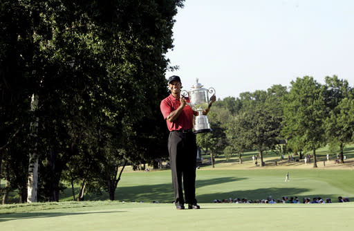 File - In this Aug. 12, 2007, file photo, Tiger Woods holds up the Wanamaker Trophy after winning the 89th PGA Golf Championship at the Southern Hills Country Club in Tulsa, Okla. The PGA Championship is returning to Southern Hills in 2022 to fill in for Trump National in New Jersey. (AP Photo/Morry Gash, File)