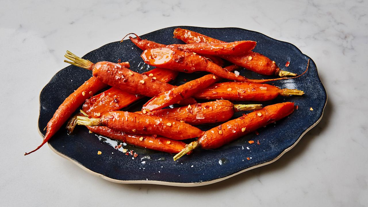 "These are the glaziest, most addictive carrots you'll ever eat. Just keep an eye on them as they near the end of their cooking time as the sugar and maple can darken quickly. <a href=""https://www.bonappetit.com/recipe/maple-roasted-carrots?mbid=synd_yahoo_rss"">See recipe.</a>"