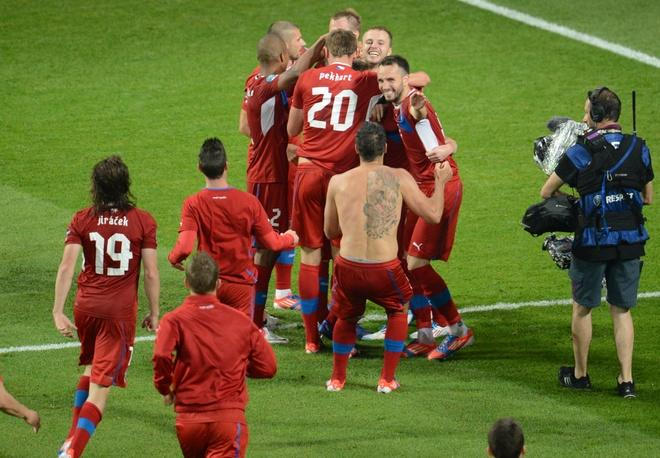 Czech players celebrate after winning the Euro 2012 championships football match between the Czech Republic and Poland on June 16, 2012 at the Municipal  Stadium in Wroclaw. AFP PHOTO / DANIEL MIHAILESCUDANIEL MIHAILESCU/AFP/GettyImages