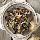 <p>When mussels and turkey sausage meet up with white wine and tomato, pure kitchen alchemy occurs in this quick dinner recipe. The broth that brews at the bottom of the pot will make you feel that a piece of crusty bread (for soaking, of course) is your new best friend.</p>