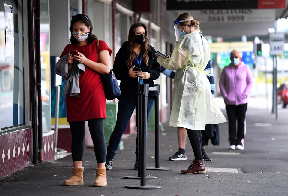 People line up for a Covid-19 test in Brisbane on Tuesday. Source: AAP