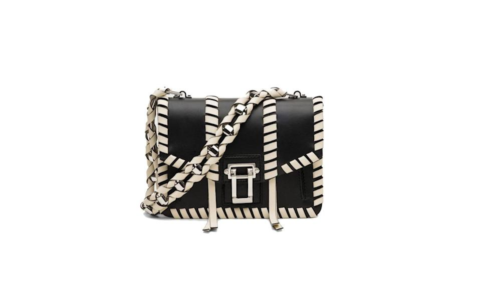"<p>Proenza Schouler's latest offering to us is structured, with a bit of whip-stitched whimsy.</p><p>Proenza Schouler Hava Chain Handbag, $2250, <a href=""https://www.proenzaschouler.com/hava-chain-handbag-h00420-c169p.html?color=Black%2FEcru"" rel=""nofollow noopener"" target=""_blank"" data-ylk=""slk:ProenzaSchouler.com"" class=""link rapid-noclick-resp"">ProenzaSchouler.com </a></p>"