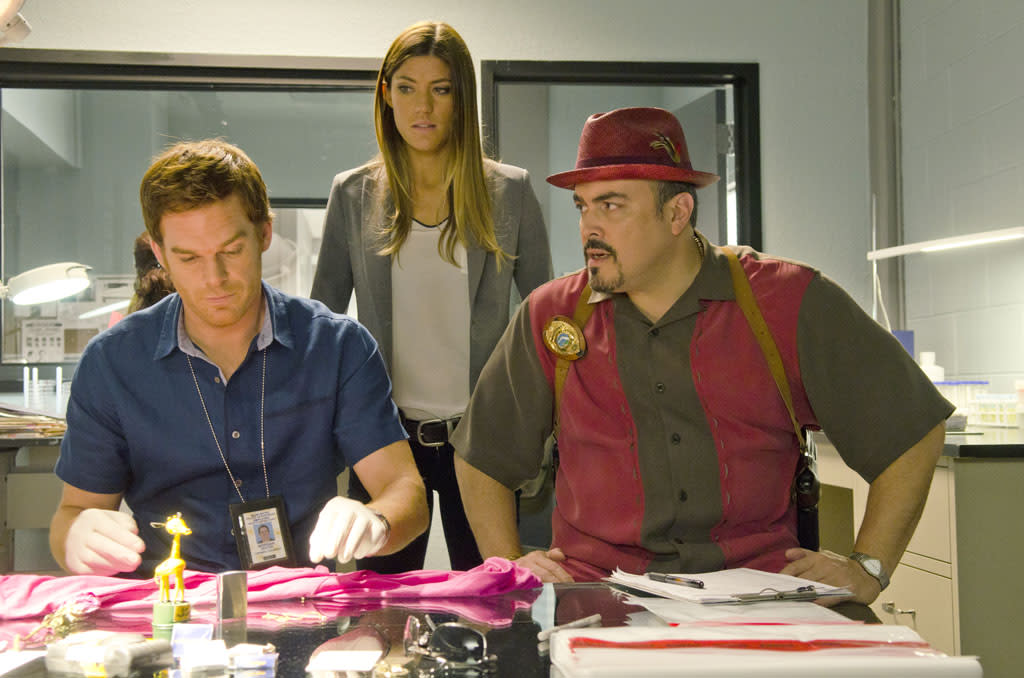 "Jennifer Carpenter as Debra Morgan, Michael C. Hall as Dexter Morgan and David Zayas as Angel Batista in the ""Dexter"" episode, ""Buck the System."""