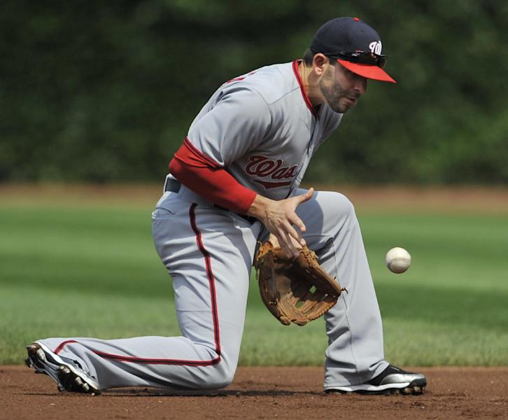 Washington Nationals second baseman Danny Espinosa stops a grounder hit by Chicago Cubs' Justin Ruggiano during the first inning of a baseball game in Chicago, Friday, June 27, 2014. Ruggiano was out at first. (AP Photo/Paul Beaty)