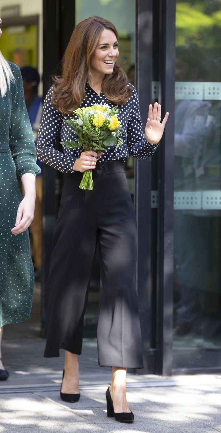 """<p>Middleton paired a pretty black and white polka dot top with wide-leg black trousers and simple black pumps <a href=""""https://www.townandcountrymag.com/style/fashion-trends/a29122046/kate-middleton-polka-dot-blouse-evelina-london-outfit-photos/"""" rel=""""nofollow noopener"""" target=""""_blank"""" data-ylk=""""slk:at an event at the Sunshine House Children and Young People's Health and Development Centre in London"""" class=""""link rapid-noclick-resp"""">at an event at the Sunshine House Children and Young People's Health and Development Centre in London</a>.</p>"""
