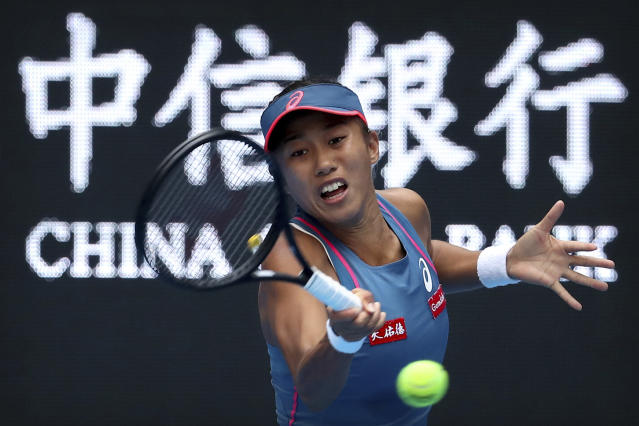 Zhang Shuai of China hits a return shot while competing against Angelique Kerber of Germany in their third round women's singles match in the China Open at the National Tennis Stadium in Beijing, Thursday, Oct. 4, 2018. (AP Photo/Mark Schiefelbein)