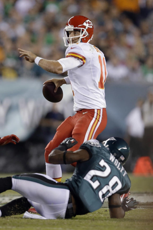 Kansas City Chiefs' Alex Smith looks to pass over Philadelphia Eagles' Earl Wolff during the first half of an NFL football game, Thursday, Sept. 19, 2013, in Philadelphia. (AP Photo/Julio Cortez)