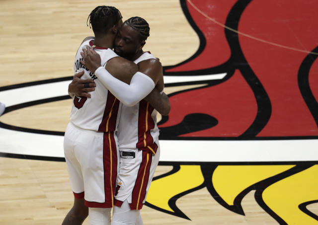 Dwyane Wade hugs Derrick Jones Jr. after playing his final home game in Miami. The two were teammates. (AP Photo/Lynne Sladky)